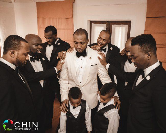 groomsmen praying before ceremony