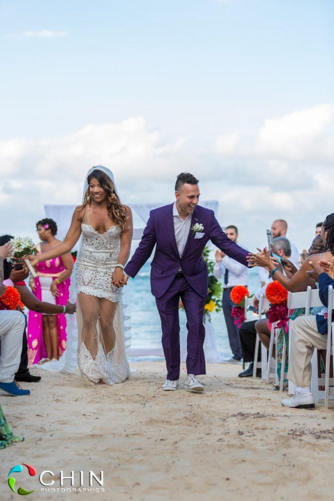 Happy bride and groom ceremony exit