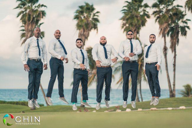 Fun groomsmen jumping