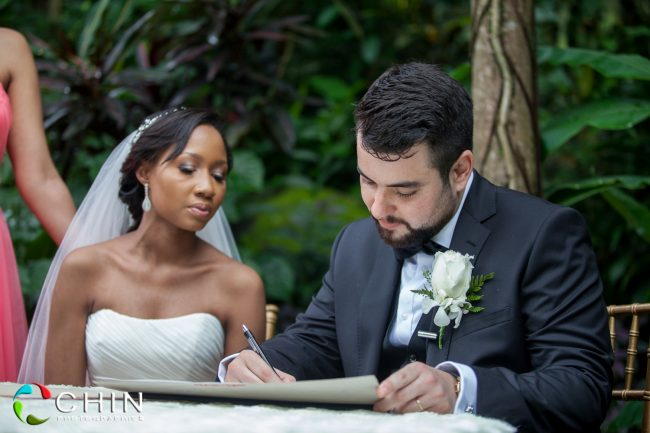 Groom signs the register