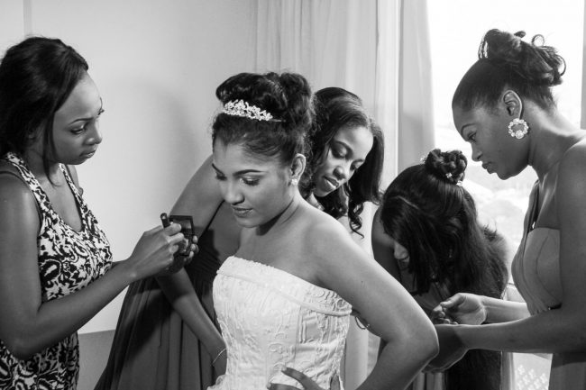bridesmaids-getting-dressed-jamaica-pegasus-weddings