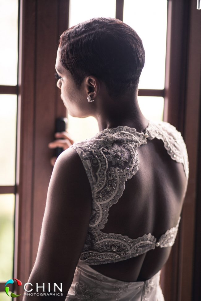 Pensive bride stares out window